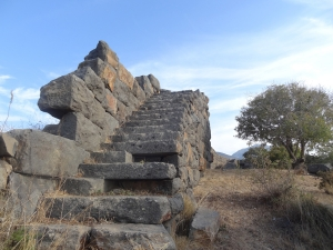 Basalt stairs of Palaiokastro, rare example of fortress from the 4th century BC. Volcanic island of Nisyros.