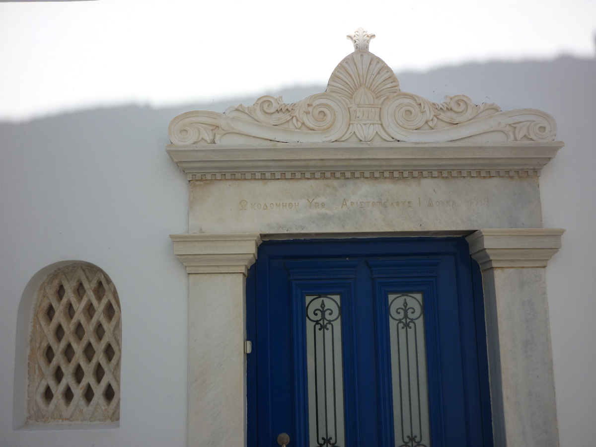 Marble pediment in the village of Pyrgos, North-West of Tinos, where is situated a famous sculpture school.