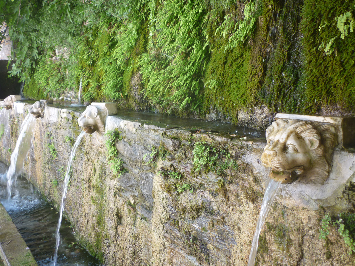 Venitian fountain in the village of Menites. Andros.